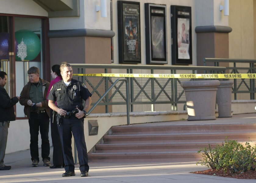 Police officers investigate a shooting at the Reading Cinemas in Carmel Mountain Saturday evening.