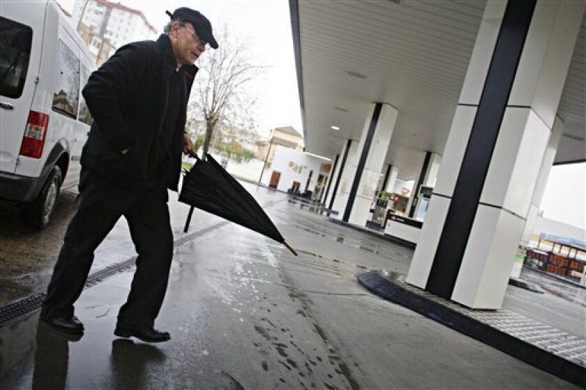 "Francisco Holgado, better known as ""Father Courage,"" walks into the gas station where his son Juan Holgado was murdered  in Jerez de la Frontera, southern Spain, on Tuesday, Nov. 30, 2010. Juan Holgado was working as a night shift gas station clerk on Nov. 22, 1995 when he was killed in Jerez. The"