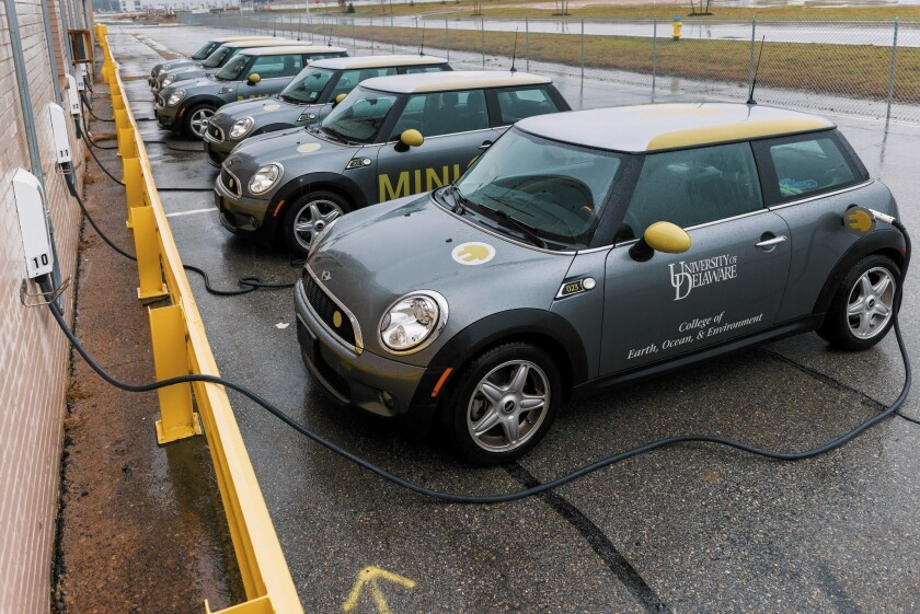 A row of Mini Coopers acts as a sort of power plant, drawing energy during off-peak times and delivering it back to the grid when it's needed most in a pilot project at the University of Delaware.