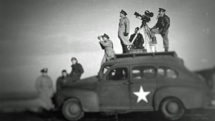 """Filmmaker John Ford shooting World War II footage, as shown in the documentary series """"Five Came Bac"""