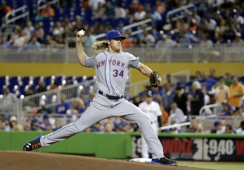 New York Mets' Noah Syndergaard delivers a pitch during the first inning of a baseball game against the Miami Marlins, Friday, June 3, 2016, in Miami. (AP Photo/Wilfredo Lee)