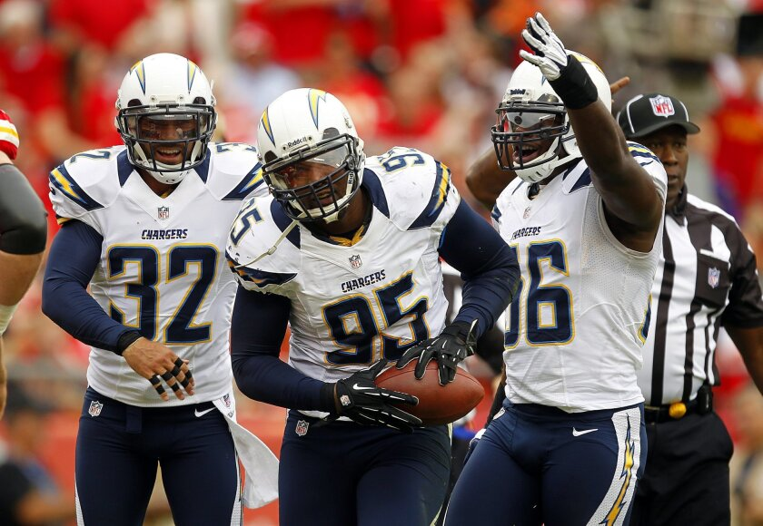 Chargers Shaun Phillips celebrates a fumble recovery in the 1st quarter on Sunday, Sept. 30, 2012.