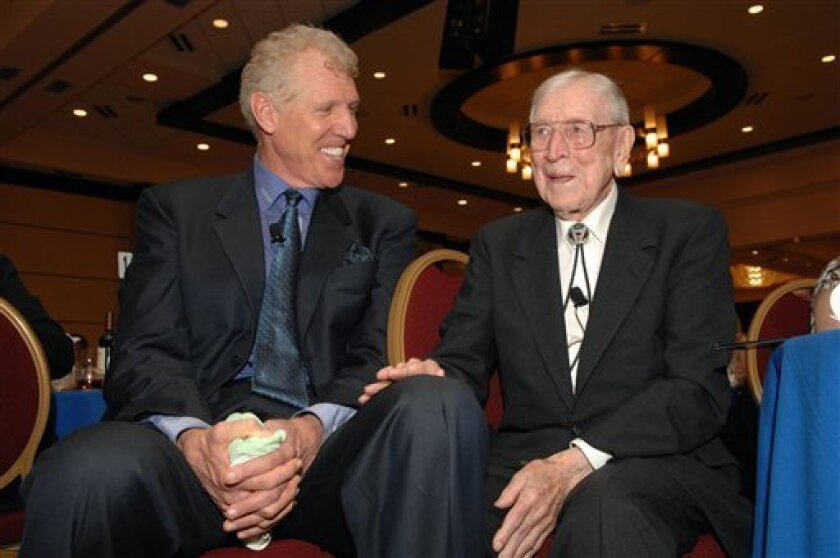 FILE - In this March 27, 2007, file photo photo provided by McDonald's, legendary UCLA basketball coach John Wooden, right, sits with Bill Walton during the banquet for the  the 30th anniversary McDonald's All American High School Basketball Games, in Louisville, Ky. Wooden led UCLA on its vaunted