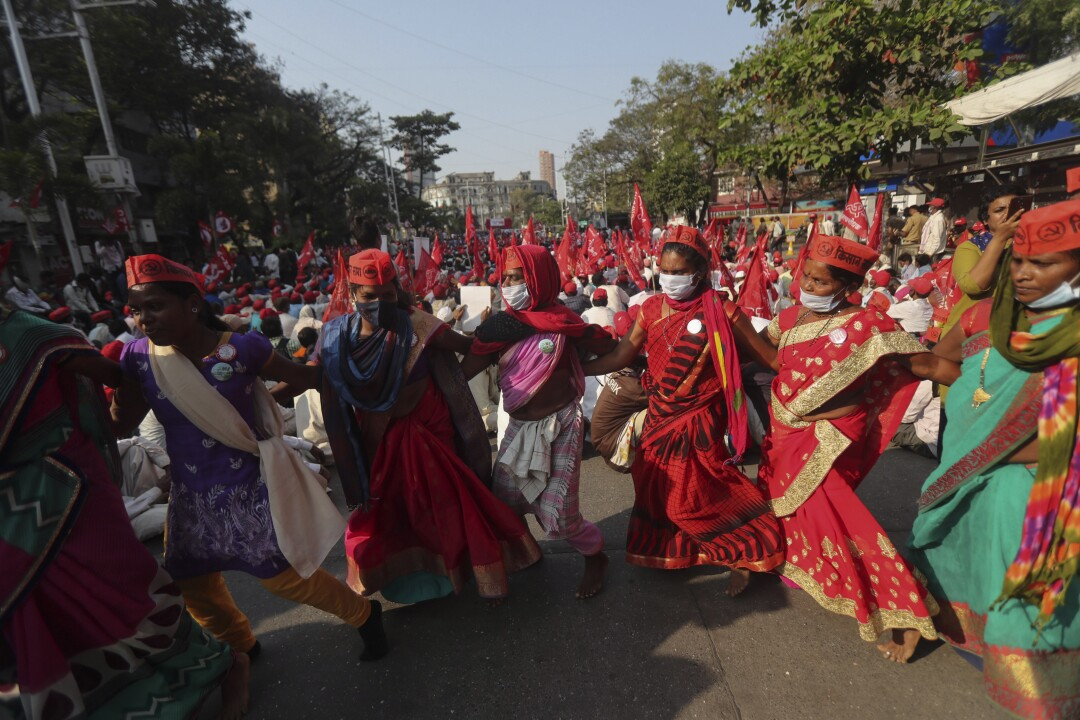 Protesting farmers dance during a rally in Mumbai, India.