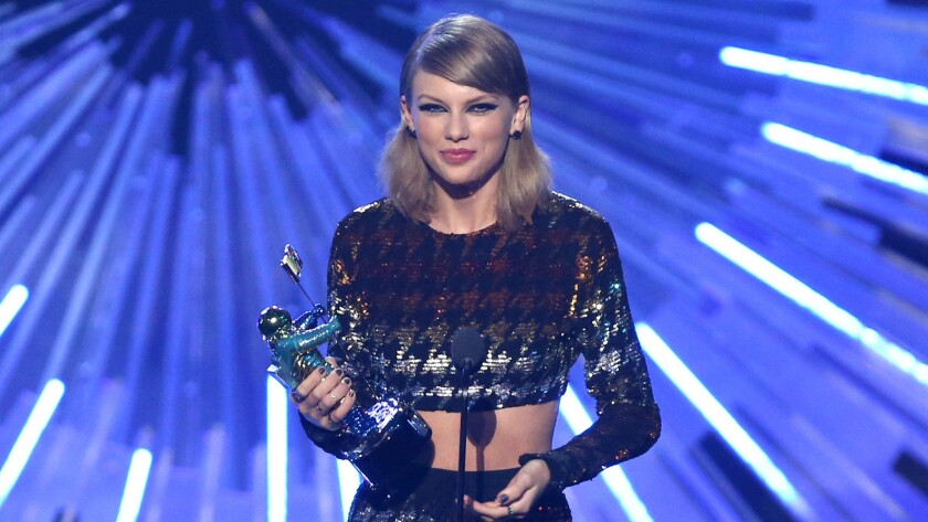 """Taylor Swift accepts the award for female video of the year for """"Blank Space"""" at the 2015 MTV Video Music Awards."""