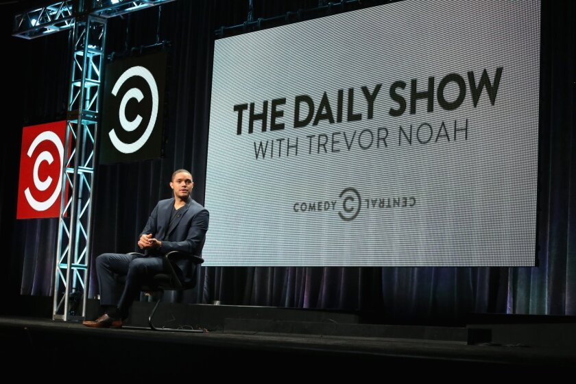 "Host Trevor Noah speaks onstage during ""The Daily Show with Trevor Noah"" panel discussion at the Viacom Networks portion of the 2015 Summer TCA Tour at The Beverly Hilton Hotel."