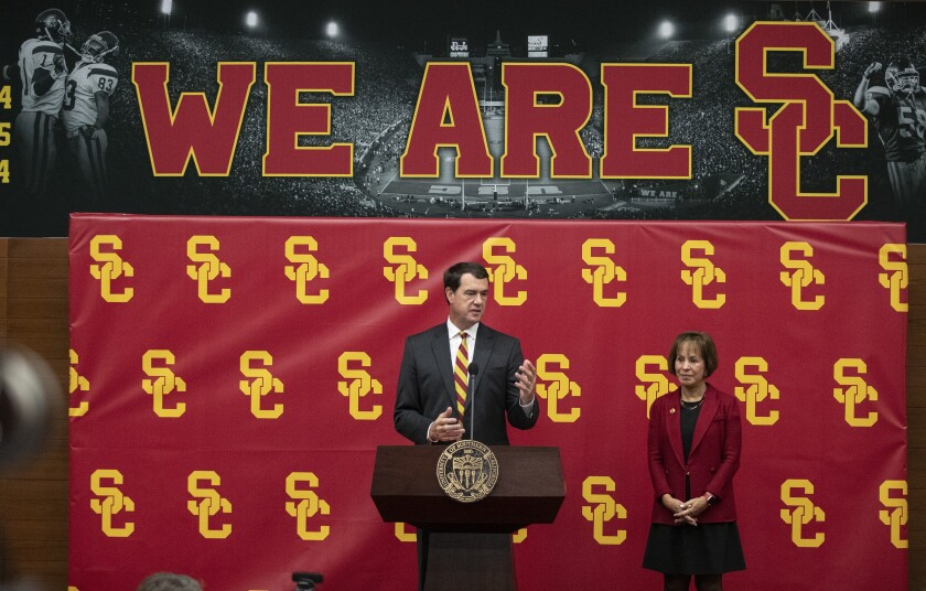 Mike Bohn speaks after being introduced as the university's new athletic director by president Carol L. Folt, right, during a news conference in November.