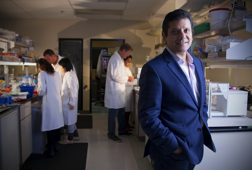Faheem Hasnain, chief executive of La Jolla-based Receptos, with other company members in the lab.