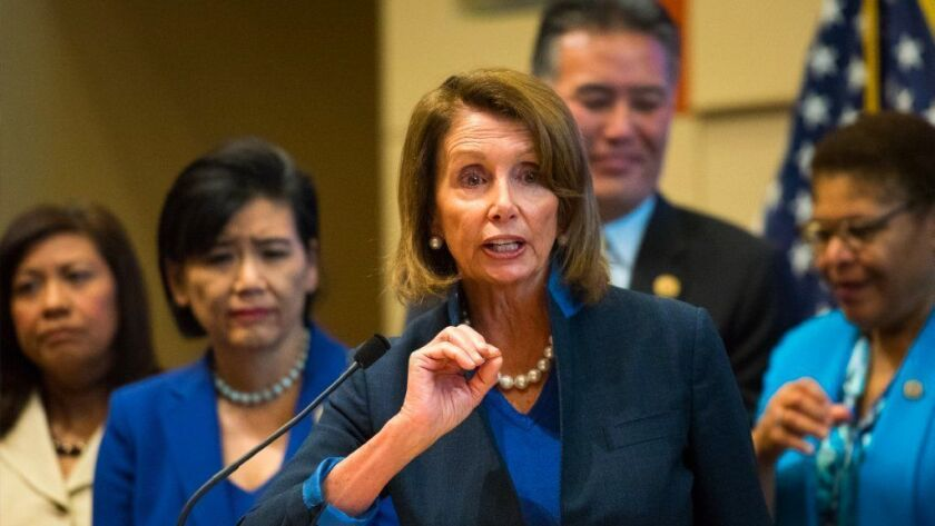 Nancy Pelosi stands with members of the Los Angeles area congressional delegation and speaks in support of protecting the Affordable Care Act at the California Endowment in downtown Los Angeles in 2017.