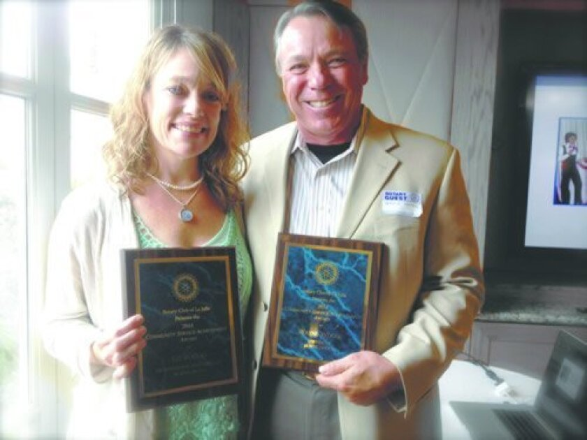Burns Drugs' Liz Rogers and Wayne Woods receive Community Service Achievement Awards from Rotary Club of La Jolla. Courtesy