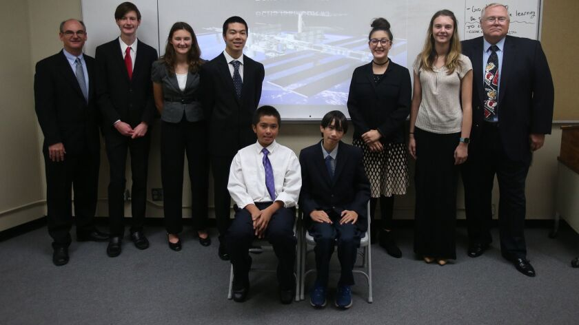 Members of Brethren Christian High's International Space Station program in the back row, Rick Peter
