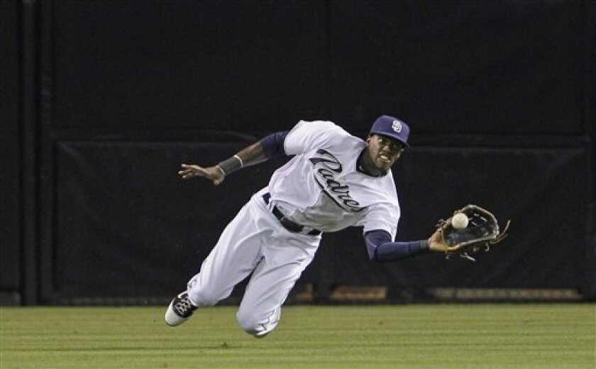 San Diego Padres center fielder Cameron Maybin makes the diving catch to rob Chicago Cubs' Starlin Castro during the first inning of a baseball game, Monday, Sept. 26, 2011, in San Diego. (AP Photo/Lenny Ignelzi)