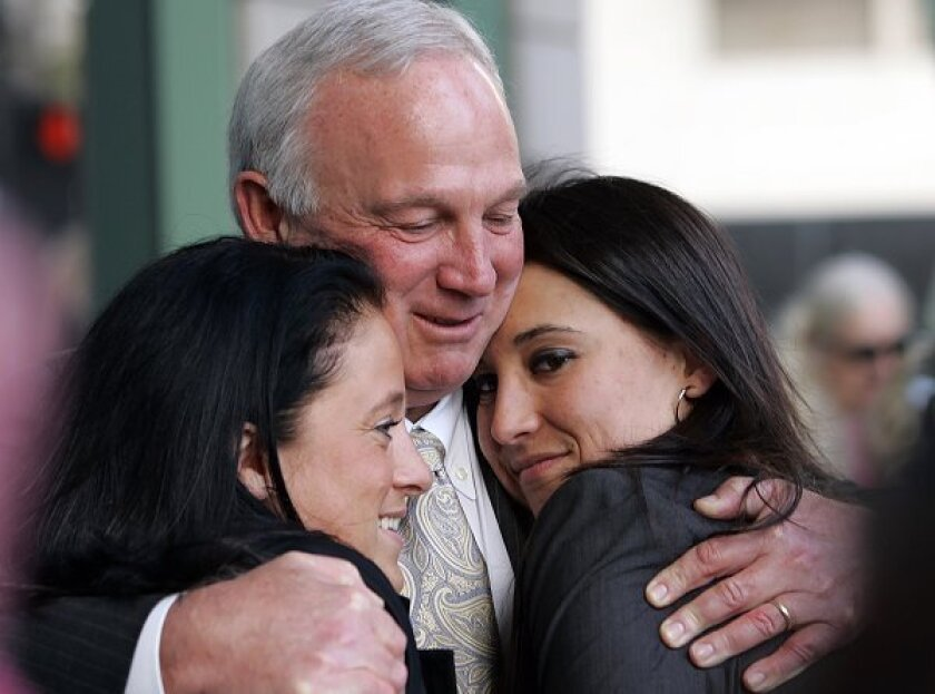 San Diego Mayor Jerry Sanders hugs his daughter Lisa, right, and her partner Meaghan Yaple, left, after Sanders spoke at a rally against Prop. 8 outside the Hall of Justice on Wednesday, March 4, 2009.