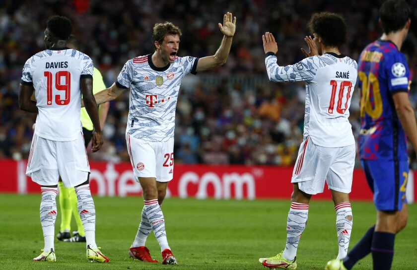 Bayern's Thomas Mueller celebrates scoring the opening goal during a Champions League group E soccer match between F.C. Barcelona and Bayern at Camp Nou stadium in Barcelona, Spain, Tuesday, Sept. 14, 2021. (AP Photo/Joan Monfort)