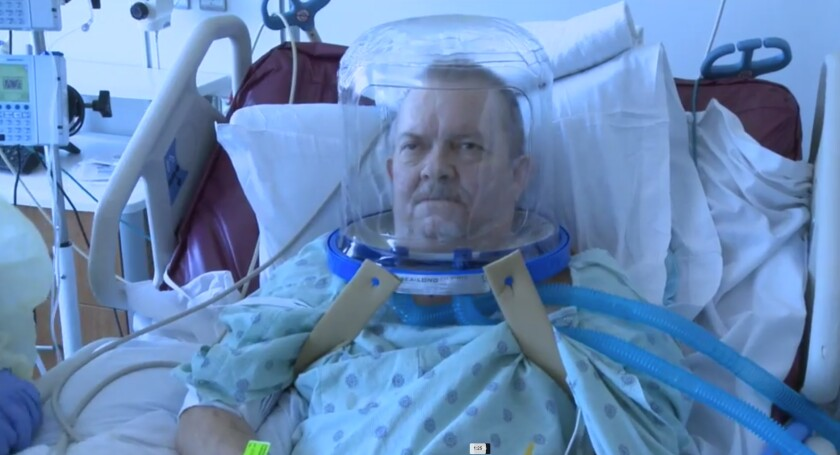 A patient is outfitted with a helmet ventilation device that is among several alternatives to traditional mechanical ventilators that doctors are considering for treating COVID-19.