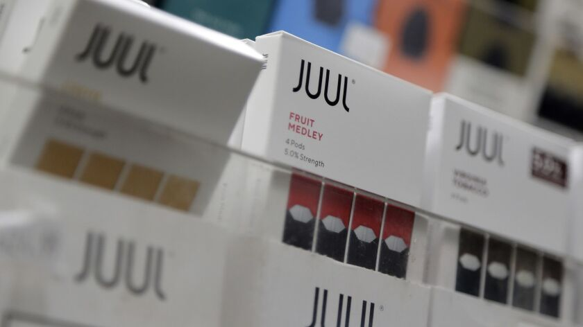 Column: A tobacco company makes Juul's founders billionaires