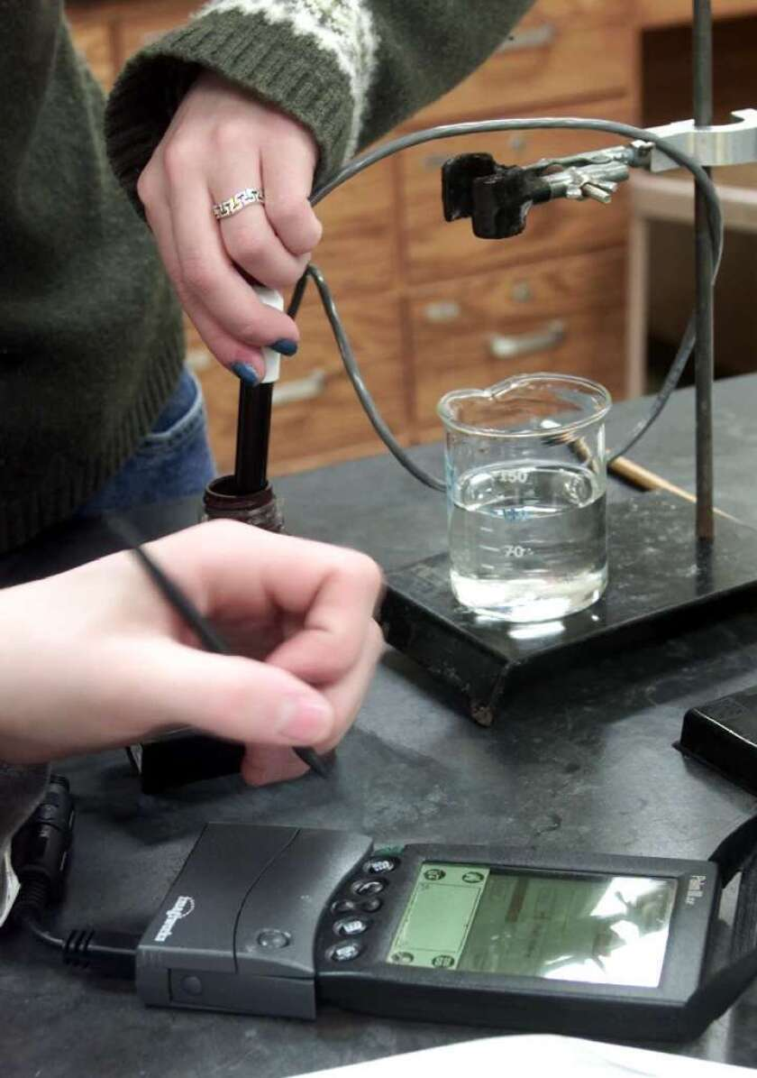 Students run an experiment in a chemistry class at an Illinois high school.
