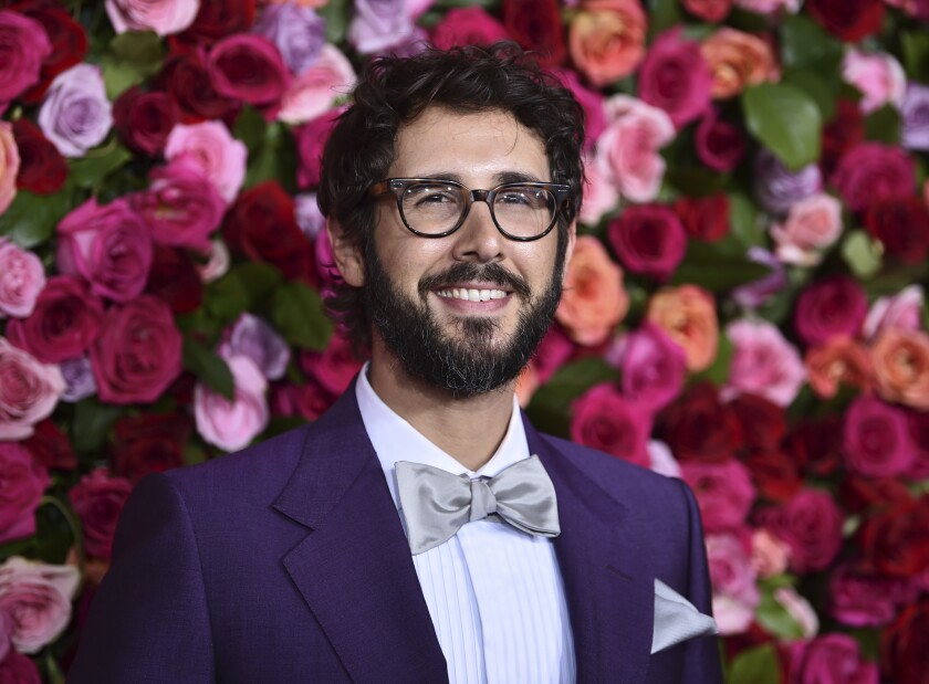 """FILE - Josh Groban arrives at the 72nd annual Tony Awards on June 10, 2018, in New York. Groban has a new album """"Harmony"""" due in November and three themed live streaming concerts, starting with a set featuring Broadway tunes in October. (Photo by Evan Agostini/Invision/AP, File)"""