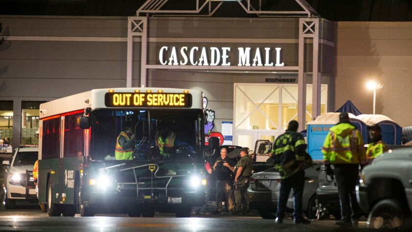 Emergency personnel gather at an entrance to the Cascade Mall in Burlington, Wash., the scene of a mass shooting on Sept. 23.