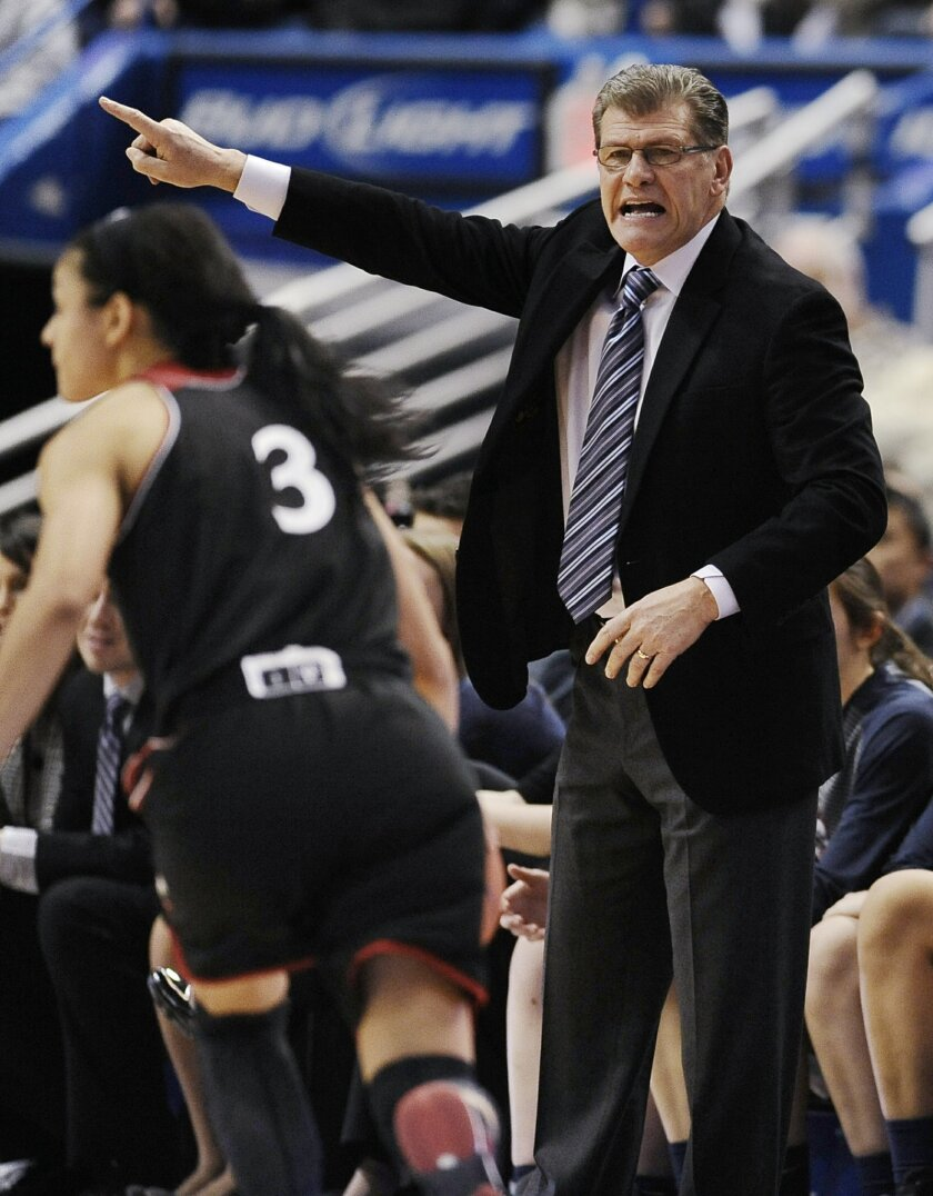 Connecticut coach Geno Auriemma, right, calls out to his team during the first half of an NCAA college basketball game against Cincinnati on Tuesday, Feb. 3, 2015, in Hartford, Conn. (AP Photo/Jessica Hill)
