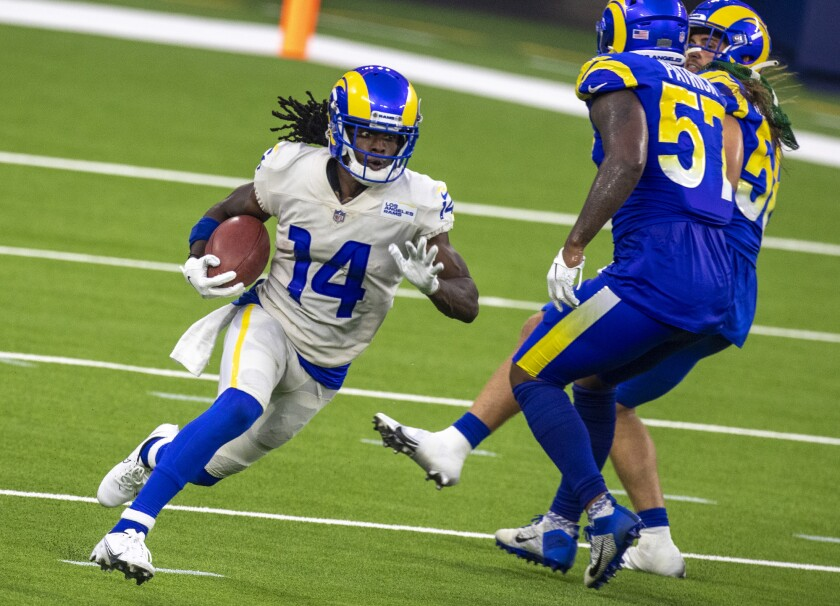 Rams' receiver Nsimba Webster returns a kickoff during scrimmage at SoFi Stadium last year.