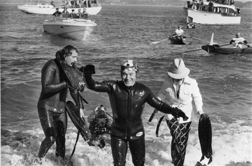 FILE - In this Nov. 7, 1975 file photo, fitness expert Jack LaLanne, 61, comes out of the chilly water after a successful swim from the Marin County side along the Golden Gate Bridge to San Francisco. Lalanne made the swim underwater, shackled and handcuffed, while towing a 2,000 pound-laden boat a
