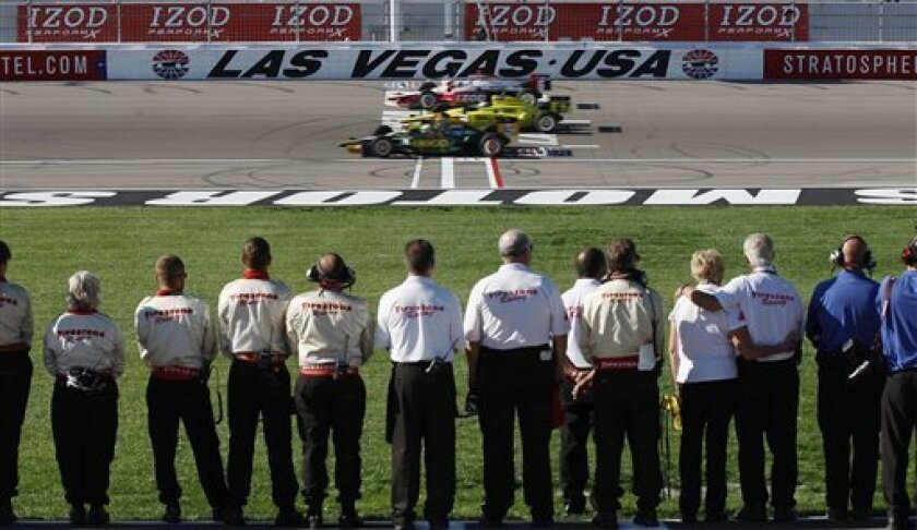 Drivers take five tribute laps in honor of Dan Wheldon, a two-time Indianapolis 500 winner who was killed in the IndyCar Series' Las Vegas Indy 300 auto race earlier Sunday, Oct. 16, 2011, in Las Vegas. (AP Photo/Isaac Brekken)