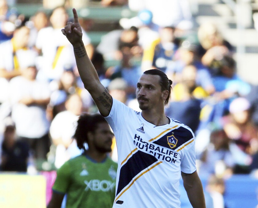 LA Galaxy forward Zlatan Ibrahimovic (9) celebrates his goal against the Seattle Sounders in the first half of an MLS soccer match in Carson, Calif., Sunday, Sept. 23, 2018. The Galaxy won 3-0.