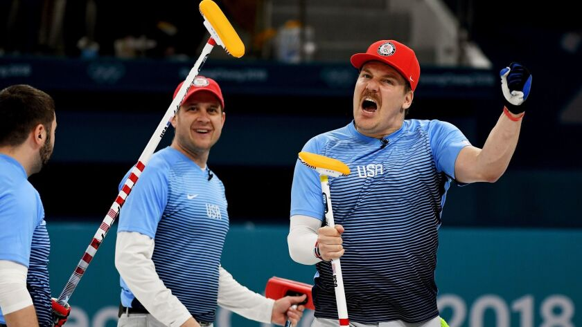 From left, U.S. curlers John Landsteiner, John Shuster and Matt Hamilton celebrate their victory over Canada in a men's curling semifinal match in Gangneung, South Korea, on Thursday, Feb. 22, 2018.