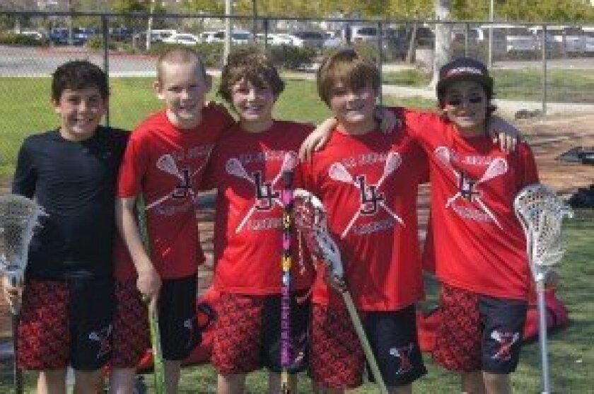 La Jolla Lacrosse Club's fourth-grade boys are happy after an early game of a winning season last spring.  Courtesy