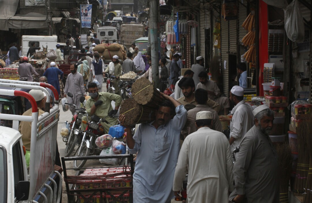 People buy groceries in Peshawar, Pakistan, in April.