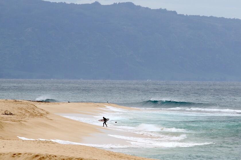 A surfer on the North Shore near Haleiwa, Hawaii.