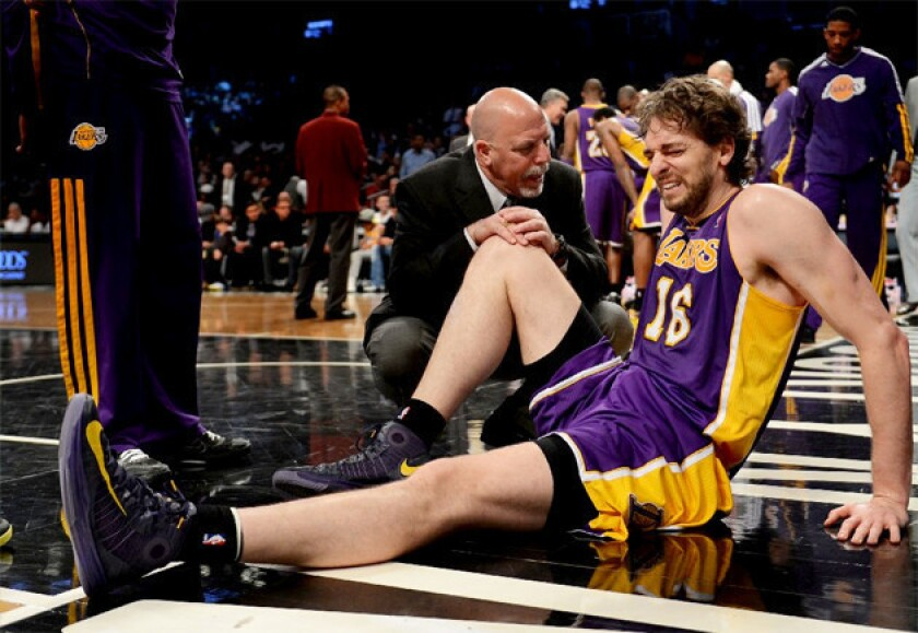 Lakers big man Pau Gasol grimaces after injuring himself against the Brooklyn Nets.