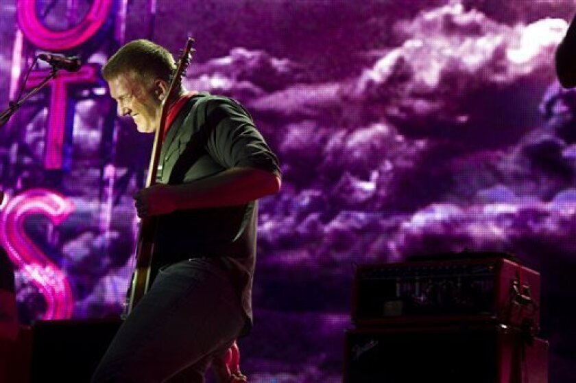 Joshua Homme from the band Queens of the Stone Age performs on day 2 of the 2013 Budweiser Made in America festival on Sunday, Sept. 1, 2013 in Philadelphia. (Photo by Charles Sykes/Invision/AP)