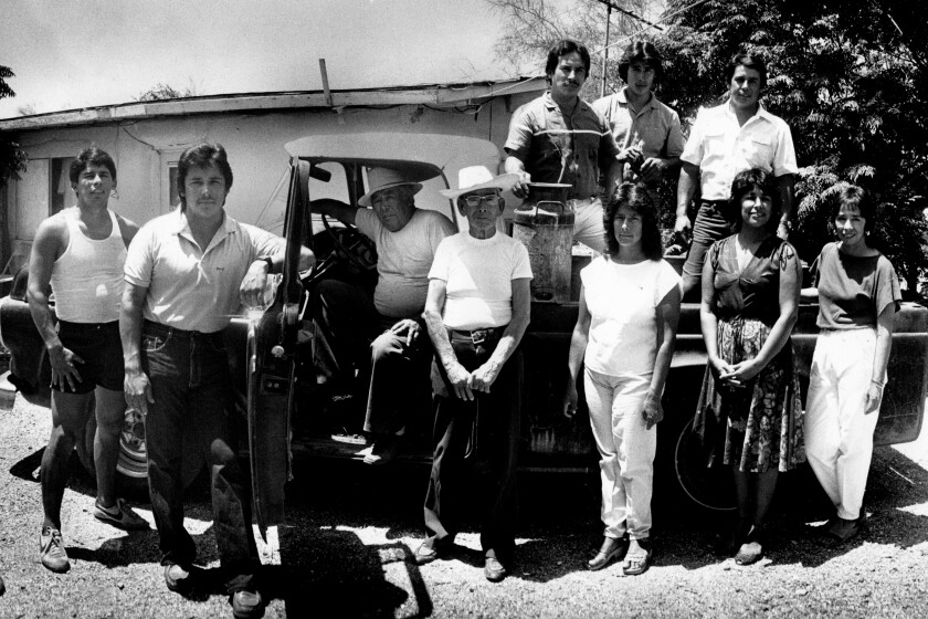 Reporter Virginia Escalante, right, with her family and their 1957 Ford pickup.