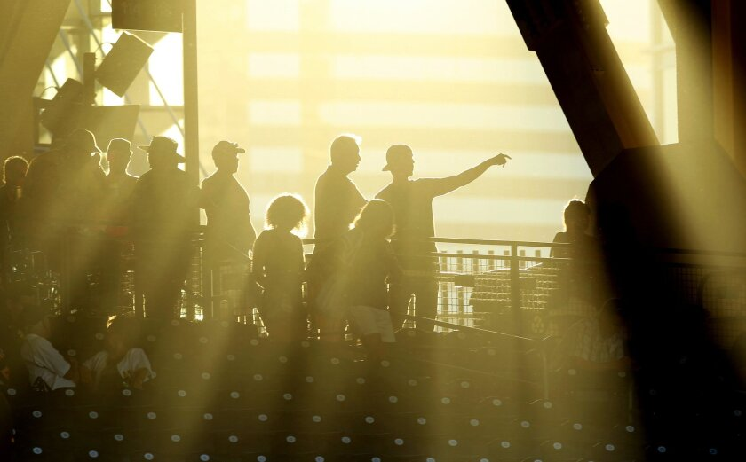 Fans enter Petco Park for the Padres-Pirates game  on Tuesday, August 21, 2012.