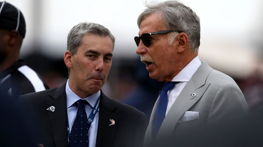 Rams owner Stan Kroenke, right, talks to chief executive Kevin Demoff along the sideline during a game against the Redskins last season at the Coliseum.