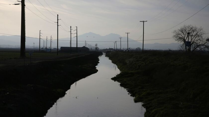 STOCKTON, CA - Feb. 25, 2016: A waterway along Route 4 in the Sacramento-San Joaquin Delta, right ou