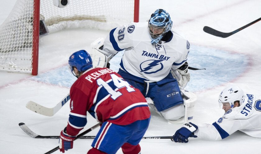 Montreal Canadiens' Tomas Plekanec scores against Tampa Bay Lightning goalie Ben Bishop during the third period of an NHL hockey game, Tuesday, Feb. 9, 2016, in Montreal.  (Paul Chiasson/The Canadian Press via AP) MANDATORY CREDIT