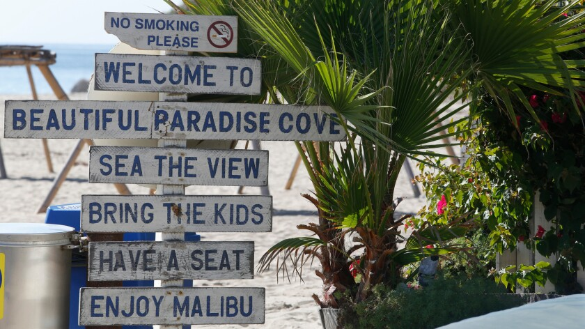 Signs welcome visitors to Malibu's Paradise Cove in 2014.