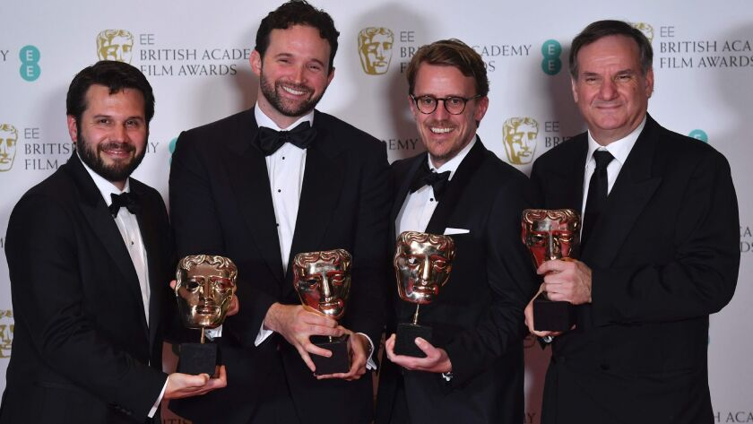 Special visual effects editors, from left, Adam Valdez, Dan Lemmon, Andrew R. Jones and Robert Legato with their awards for Special Visual Effects for their work on the film 'The Jungle Book' at the BAFTA British Academy Film Awards in London on Feb. 12.