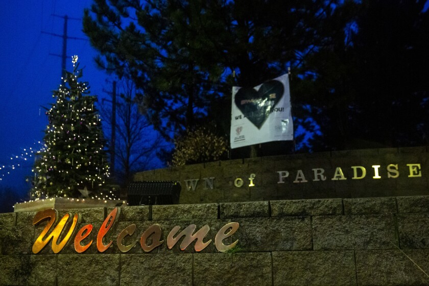 PARADISE, CALIF. - DECEMBER 14: A Christmas Tree sits next to the Paradise town sign on Friday, Dec.