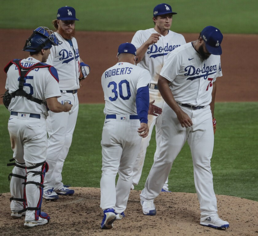 Los Angeles Dodgers relief pitcher Kenley Jansen (74) is pulled from the game