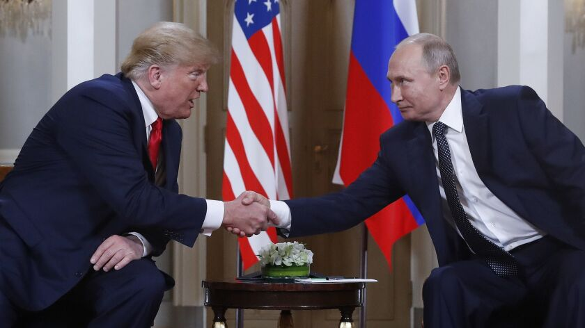 President Trump and Russian President Vladimir Putin greet each other July 16 at their meeting in Helsinki, Finland.