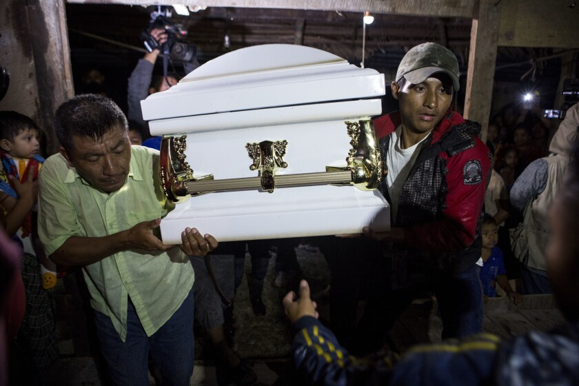 Neighbors carry the coffin that contain the remains of 7-year-old Jakelin Caal Maquin into her grand