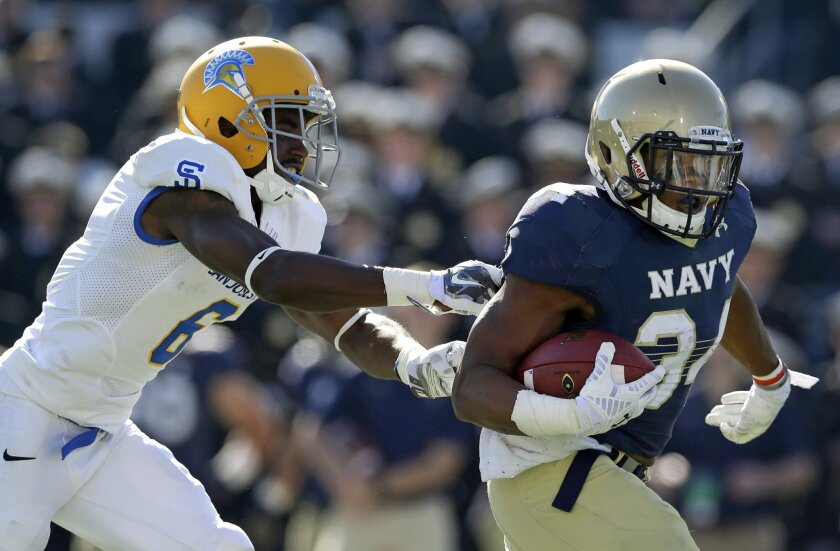 Navy fullback Noah Copeland, right, rushes past San Jose State cornerback Cleveland Wallace for a first down in the first half of an NCAA college football game in Annapolis, Md., Saturday, Oct. 25, 2014. (AP Photo/Patrick Semansky)