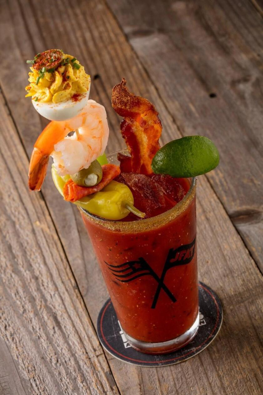 Jimmy's Instagram-famous 'Meal Mary' — a meal in a drink, with a deviled egg, bacon and grilled shrimp.