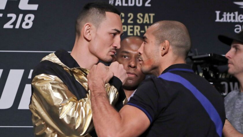 Max Holloway, left, and Jose Aldo get in each other's face on Nov. 30 in Detroit during media day for UFC 218.