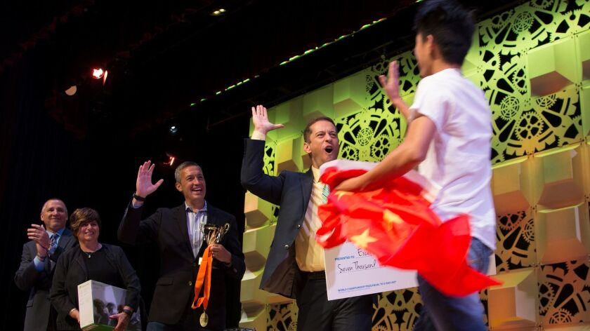 ANAHEIM, CA - AUGUST 2, 2017 : JiaXi Dai of China gets a high five from Aaron Osmond, general mana