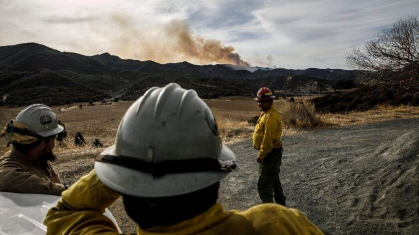 A crew from the Four Corners region of Arizona monitors the Thomas blaze, which has burned more than 280,000 acres, on Christmas.